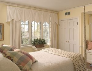 Double-hung windows in a bedroom