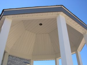 Close-up of the soffit and fascia of a gazebo from the ground
